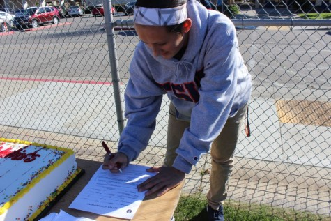 Varsity soccer player Hailey Pohevitz participates in a mock signing at BCCHS on Feb.2.