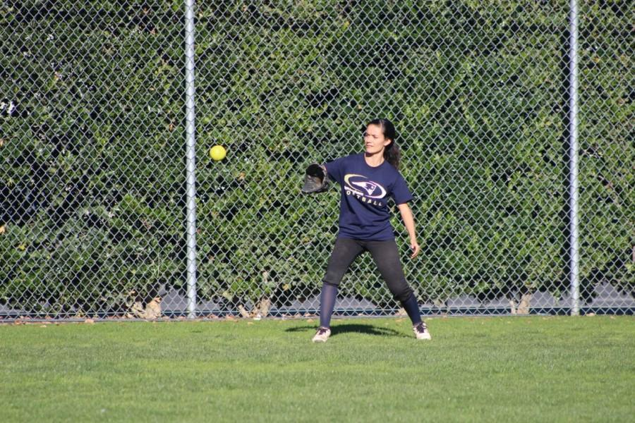 Freshman Genevieve Avalos positions herself to catch the ball. Avalos is the first freshman on varsity.