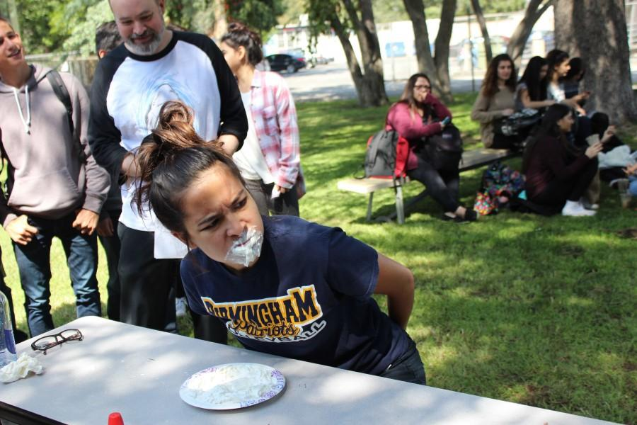 Senior Michal Francisco participates in the pie eating contest during Fiesta Friday.