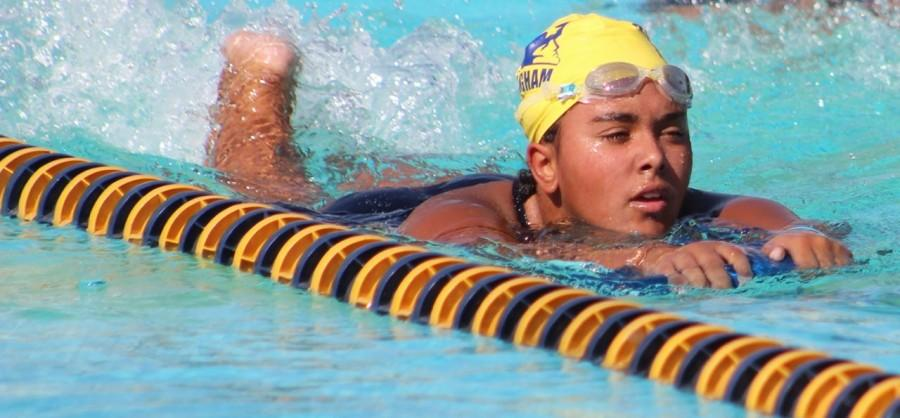 Junior Kyrah Hunter practices her swimming technique.