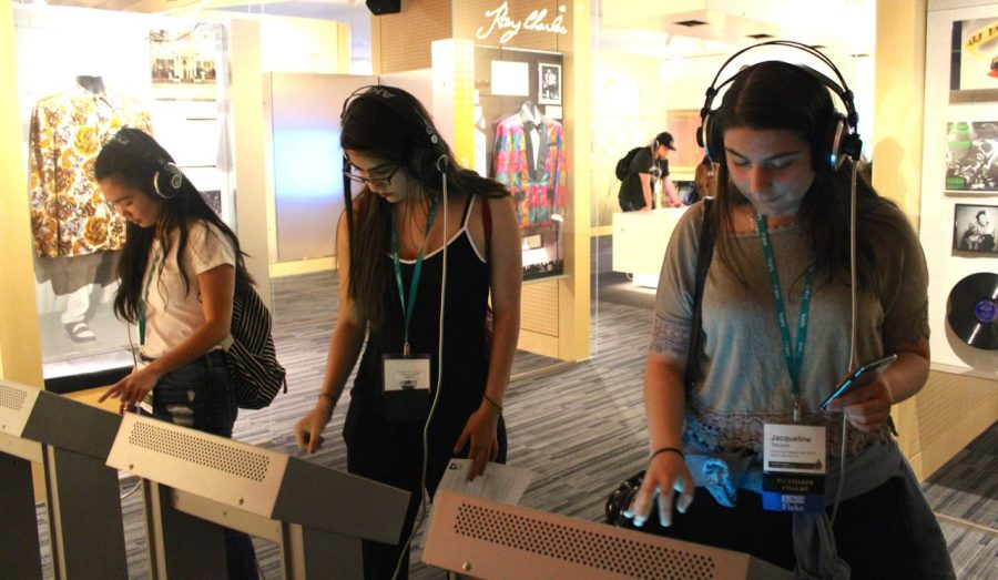 Seniors Marcy Vegara, Veronica Godoy, and Jackie Tatulyan explore the interactive features at the Grammy Museum.