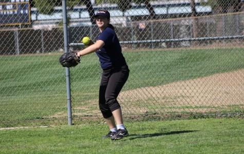 Sophomore Rachel Bullock prepares to throw the ball. She is a left fielder for BCCHS'  JV  softball team.