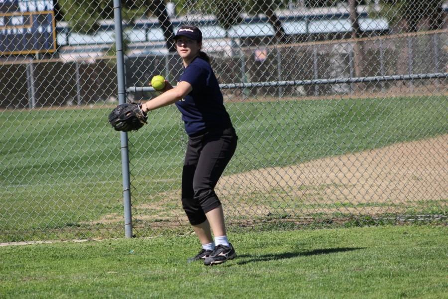 Sophomore Rachel Bullock prepares to throw the ball. She is a left fielder for BCCHS'  JV  softball team.