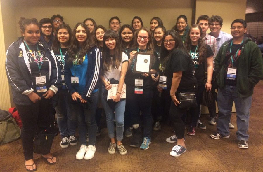 Daniel Pearl Magnet High School students celebrate with their Online Pacemaker award.