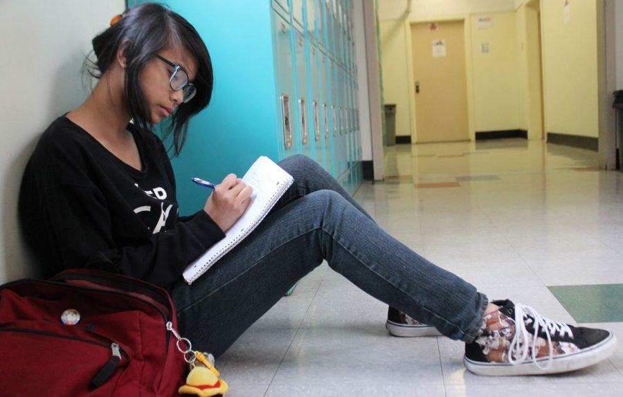 Junior France Cheska uses the school hallway as inspiration for her writing. She has written three books of poetry and is waiting to have them published in the next year or two.