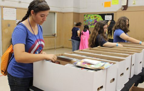 Sophomore Rachel Bullock searches through boxes of comic books from DJ's Universal Comics.
