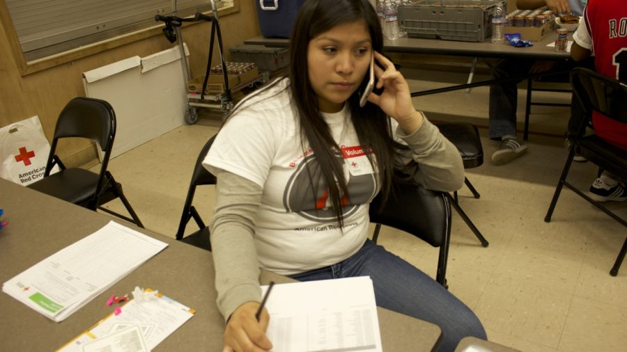 Senior Nely Correa volunteers at the blood drive by collecting names of the students donating. Photos by Anne Lima.