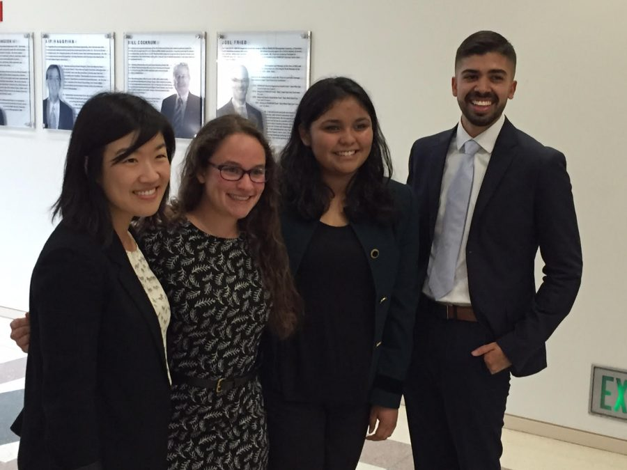 Online Editor-in-Chief Rebekah Spector and Sports Editor Elsie Morales stand with two UCLA students during their private interview.