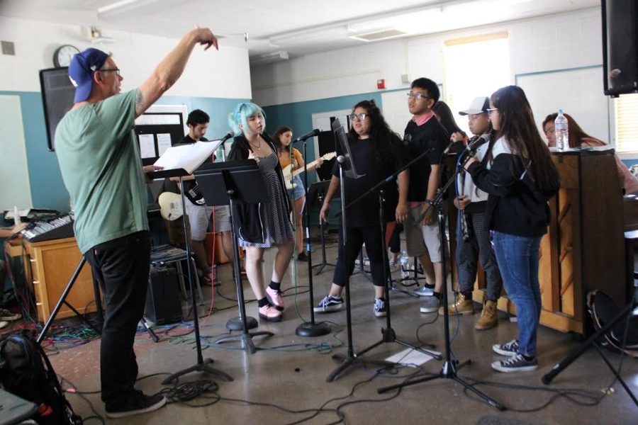Music Teacher Wes Hambright leads students in graduation rehearsal.