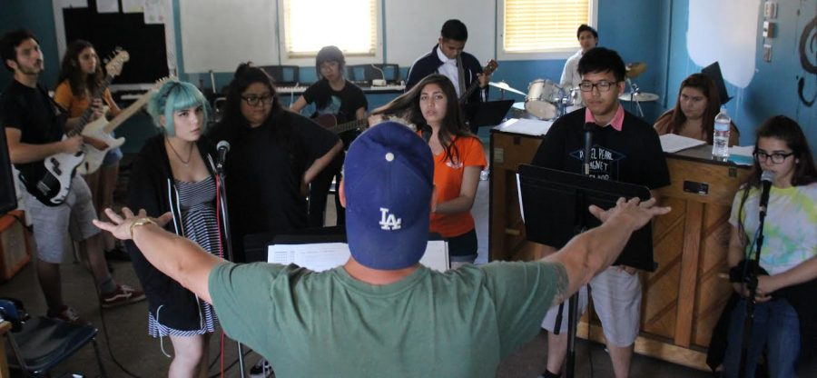 Music Teacher Wes Hambright leads students in graduation rehearsal in preparation for the June 9 ceremony.