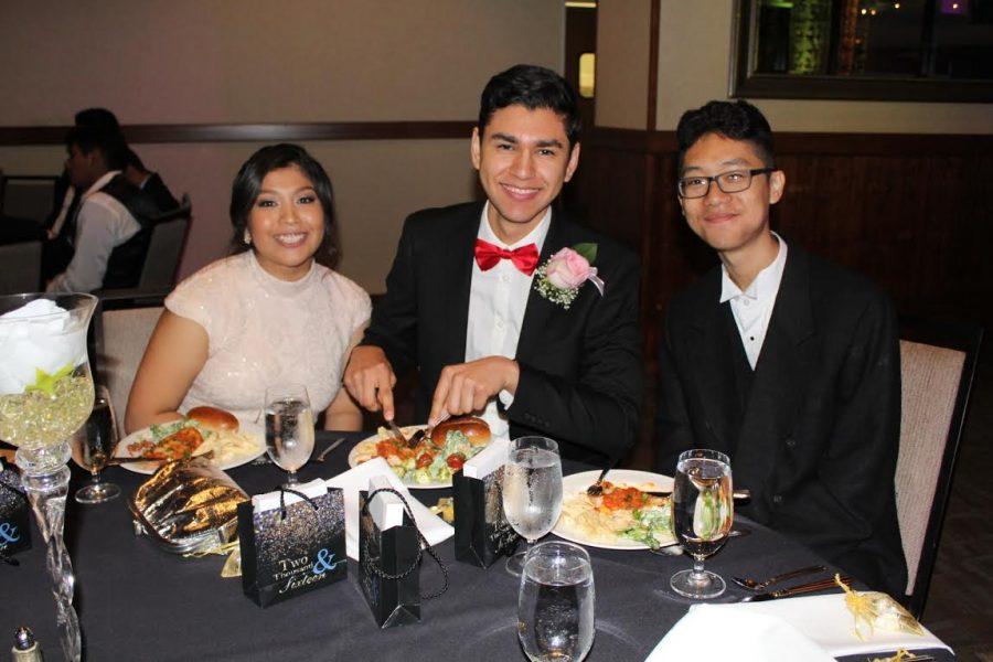 Seniors Nely Correa, Jason Valladarez and Patrick De Guzman pose together at the table.