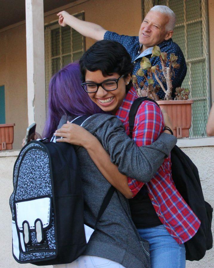 Junior Nixia Bravo hugs friend Katilyn Arst on the first day of school.