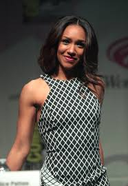 """Iris West (Candice Patton) from CW's """"The Flash"""" is one person of color on the screen with superheroes."""