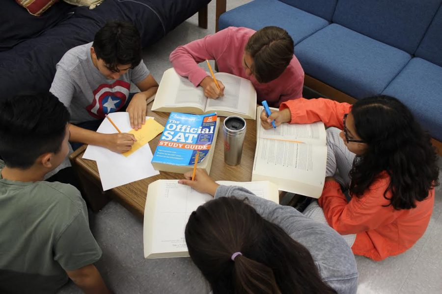 A group of students study  in the school library for the updated SAT, which some students have mixed feelings about.