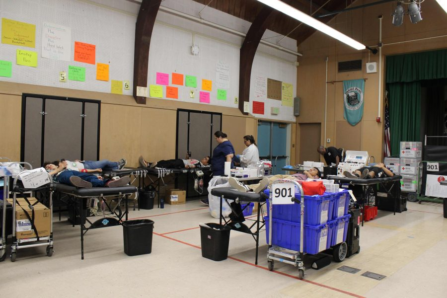 Students save three lives by taking part in the blood drive at school today.
