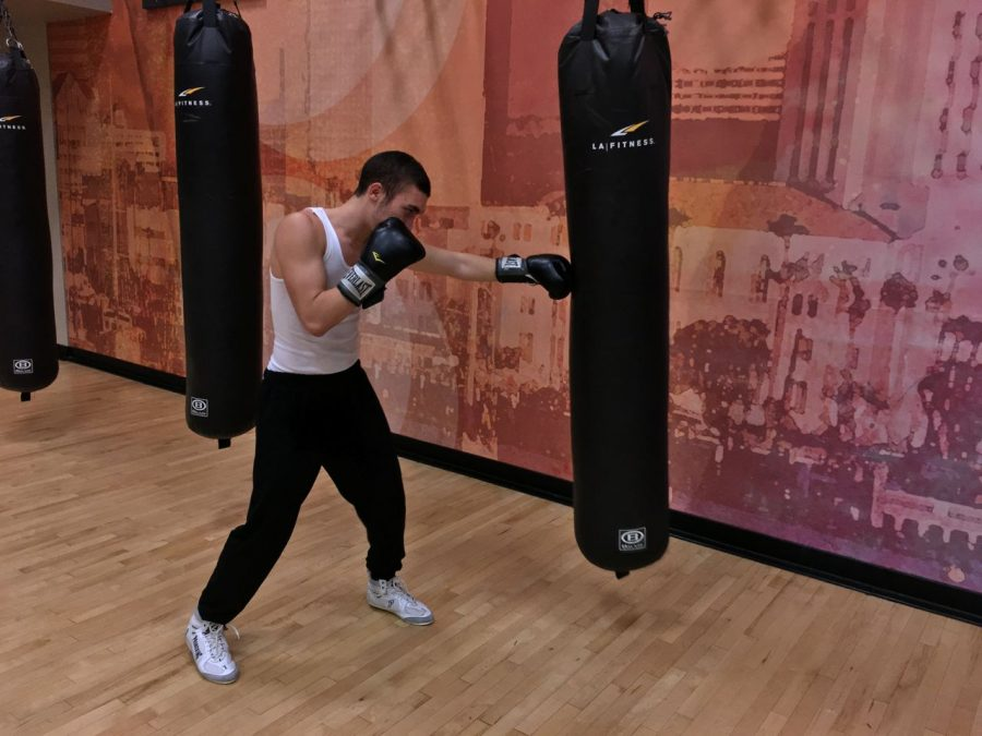 Senior+Gera+Pimenov+practices+his+punches+at+his+local+LA+fitness+gym.+Pimenov+has+been+boxing+for+since+March.
