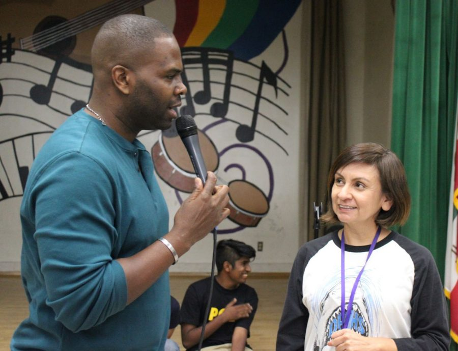 Manager of Arts Education for Get Lit Paul Mabon asks journalism teacher Adriana Chavira her favorite Starbucks drink.