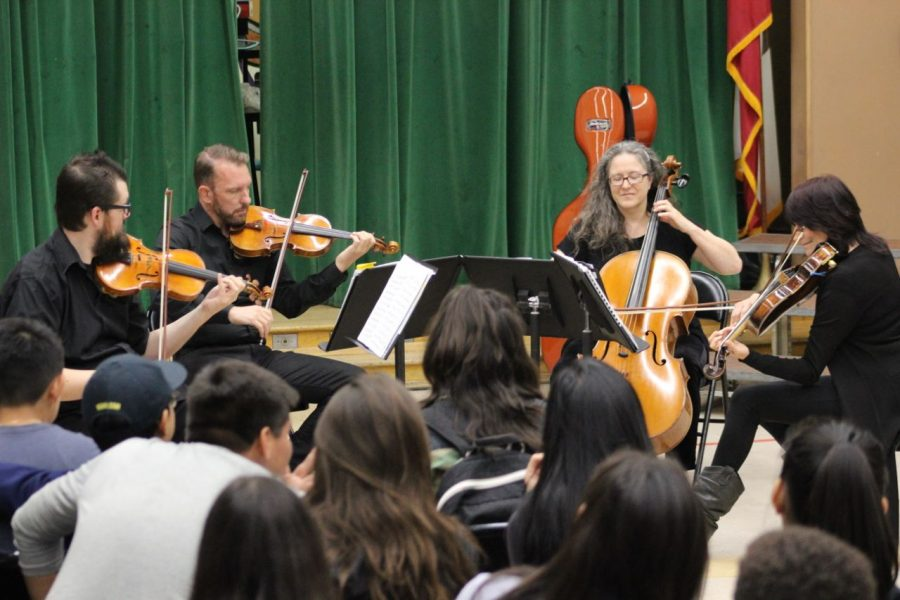 The Kadima String Quartet engages students with their performance.