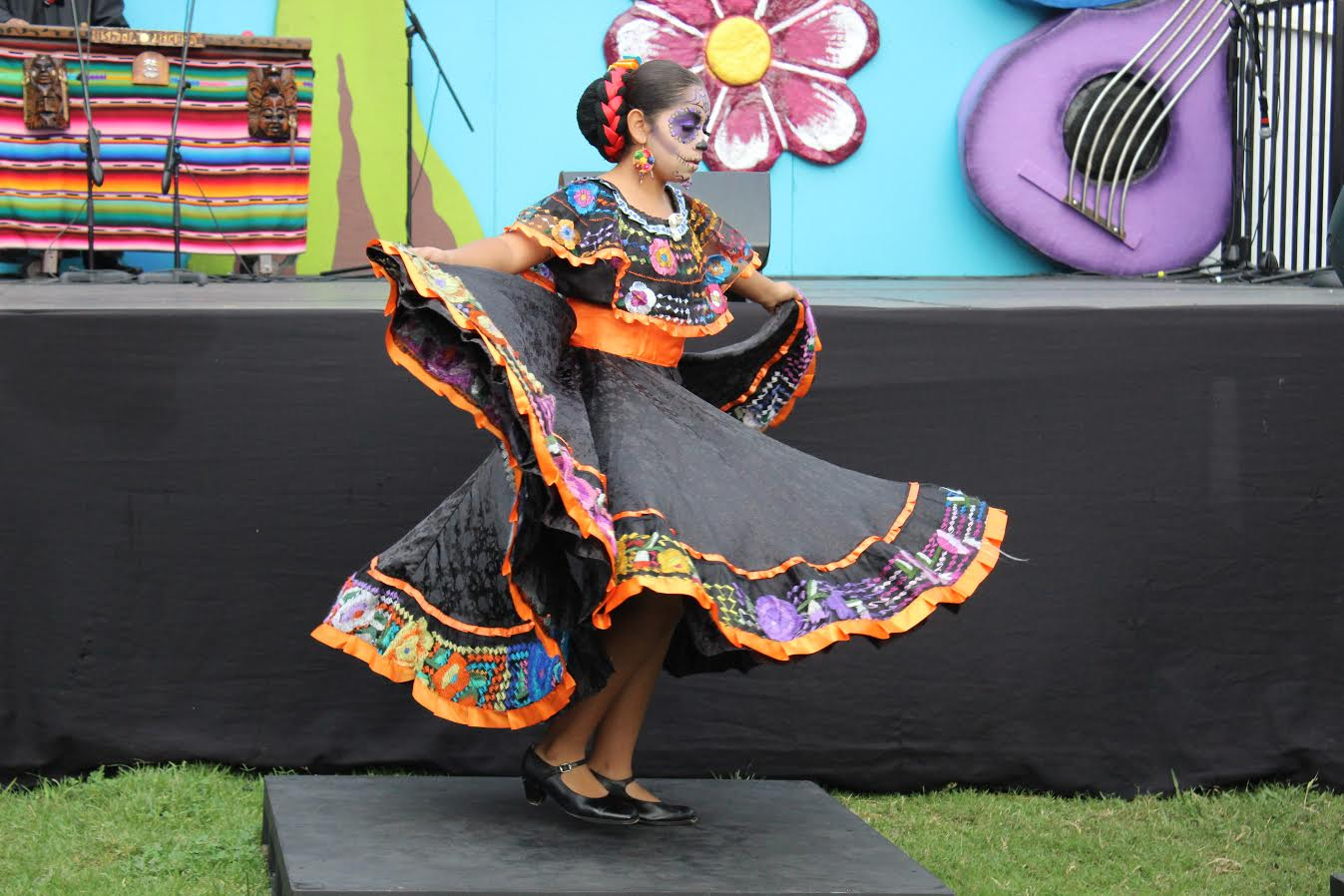 A young girl takes part in the folklorico performance.