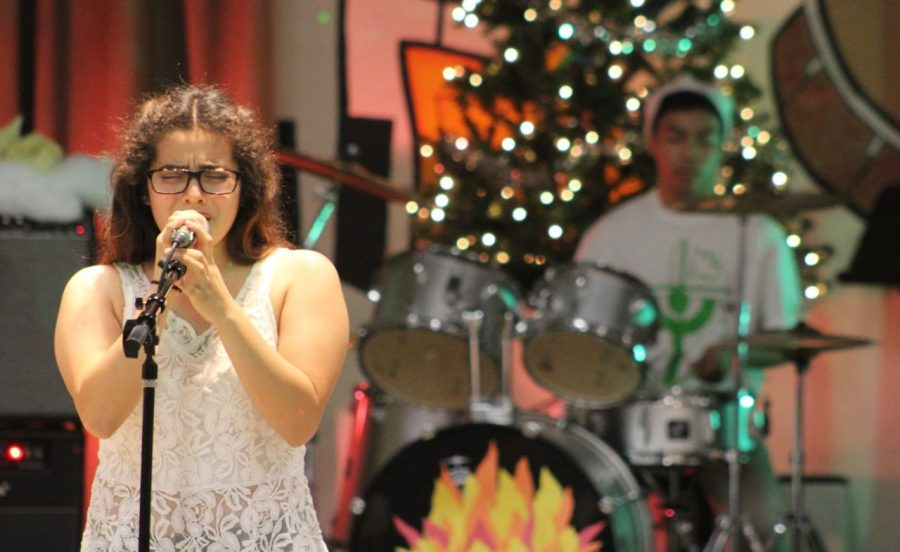 Senior Ana Monterroza sings while the band performs behind her. The choir sang a variety of songs from