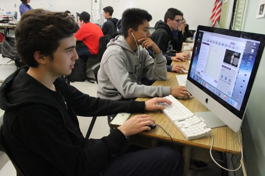 Senior Justin Houston participates in the Hour of Code.