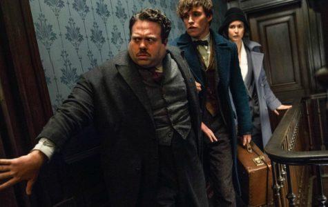 Photo by IMDB Dan Fogler (Jacob Kowalski), Eddie Redmayne (Newt Sc amander), and Katherine Waterston (Porpentina Goldstein) sneak around in Time Warner Brothers newest film.