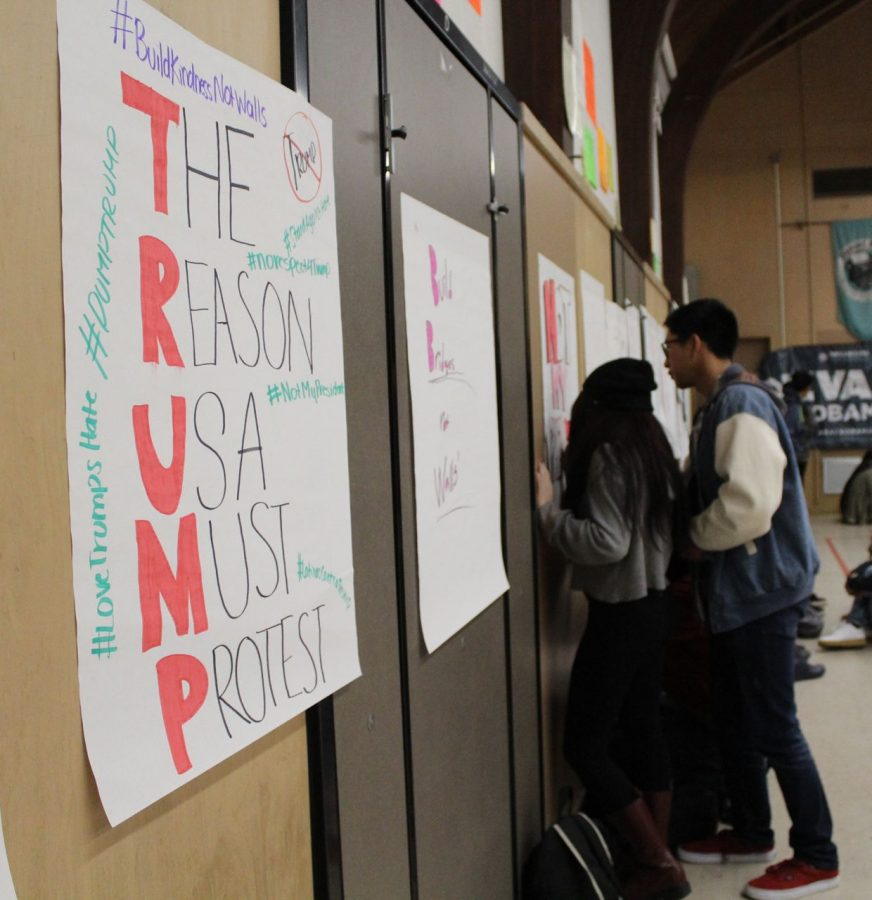 Seniors Jonas Acebes and Vivian Rodriquez participate in the sit in by making anti-Trump posters. Those who participated all made posters as well.
