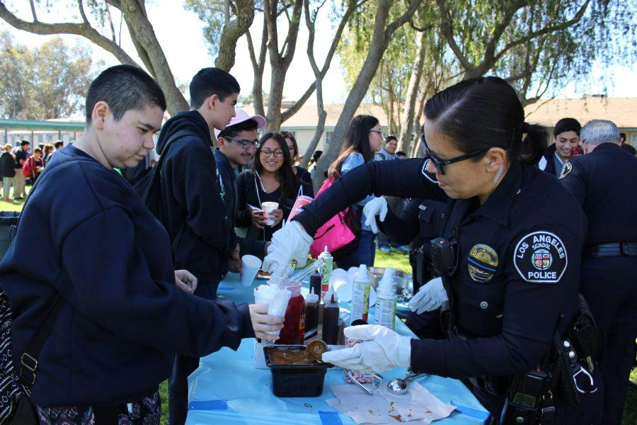 Junior Lisset Bayardo and a Los Angeles School Police officer participate together.