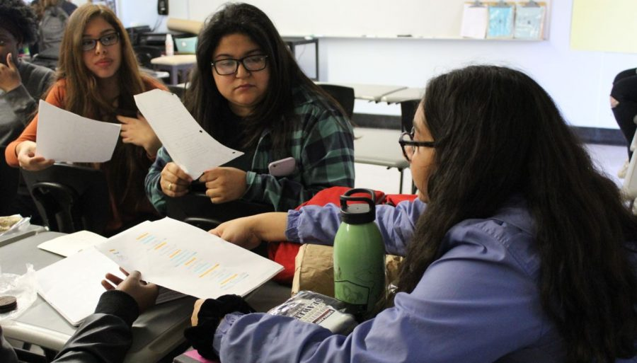 Poets Amanda Jimenez, Ruby Rodriquez and Angel Rivera practice their group poem in english teacher's Ron Baer's room.