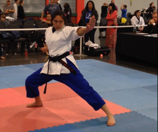 Black belt Keona Paniagua competing in a tournament.
