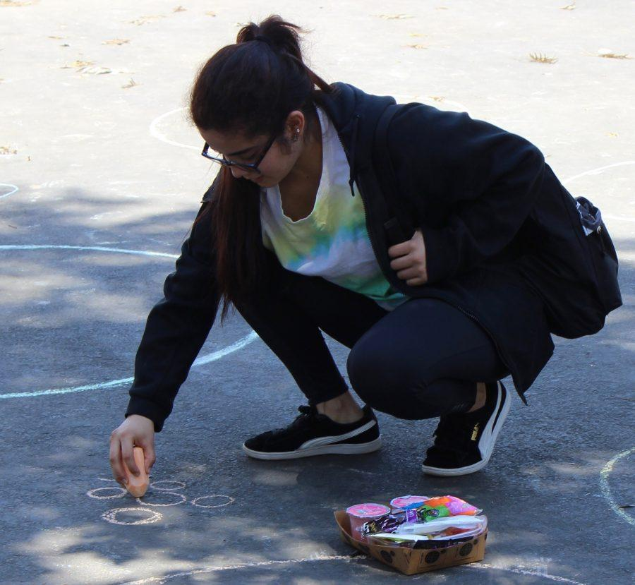 Senior Ana Monterroza attempts to draw a perfect circle during Pi Day.