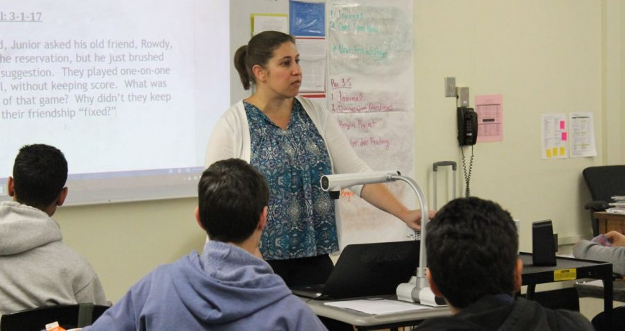 Teacher of the year nominee Leah Pevar teaches to her english class about context clues. Pevar has been part of the Shark family for two years now.