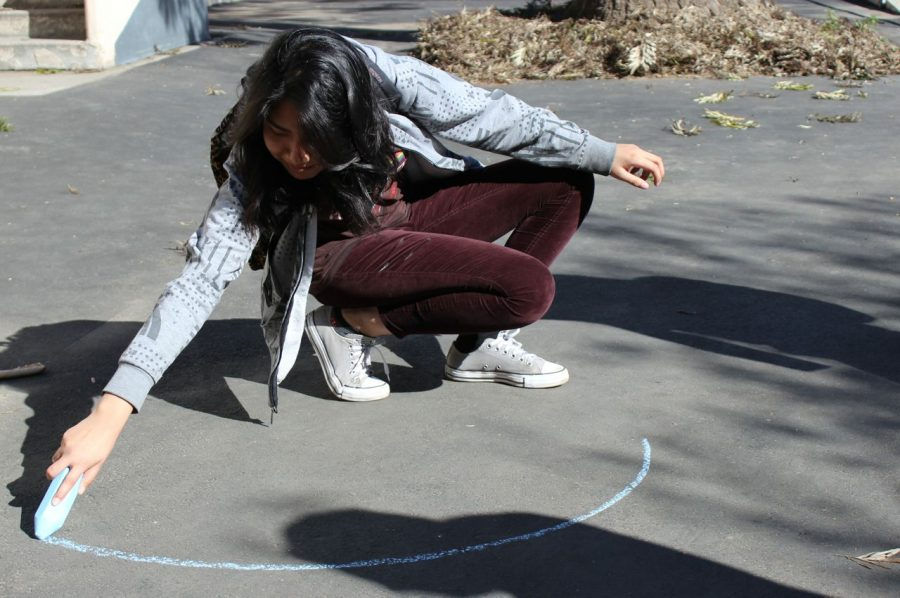 Sophomore Marjorie Hernandez participates in the perfect circle contest presented by math teacher Dan Cramer in celebration of Pi Day.