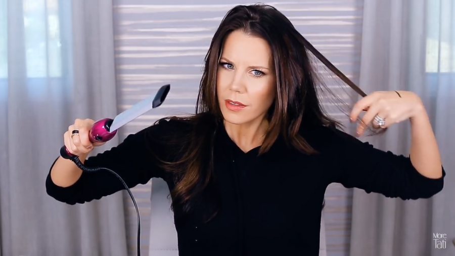 Screenshot from YouTube Tati Westbrook reviews expensive and drug store beauty products for her fans.