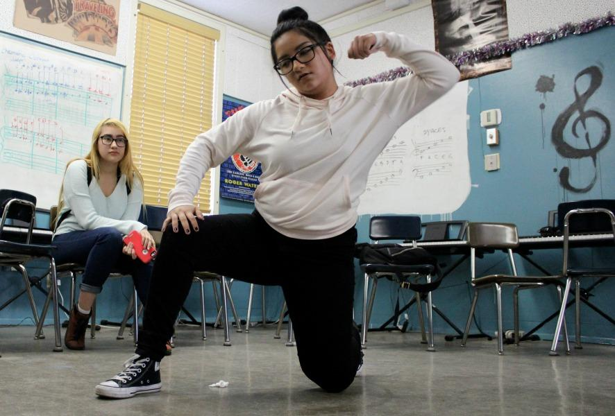 Junior Harmony Sanchez practices her hip-hop choreography as junior Sandra Ortega watches.
