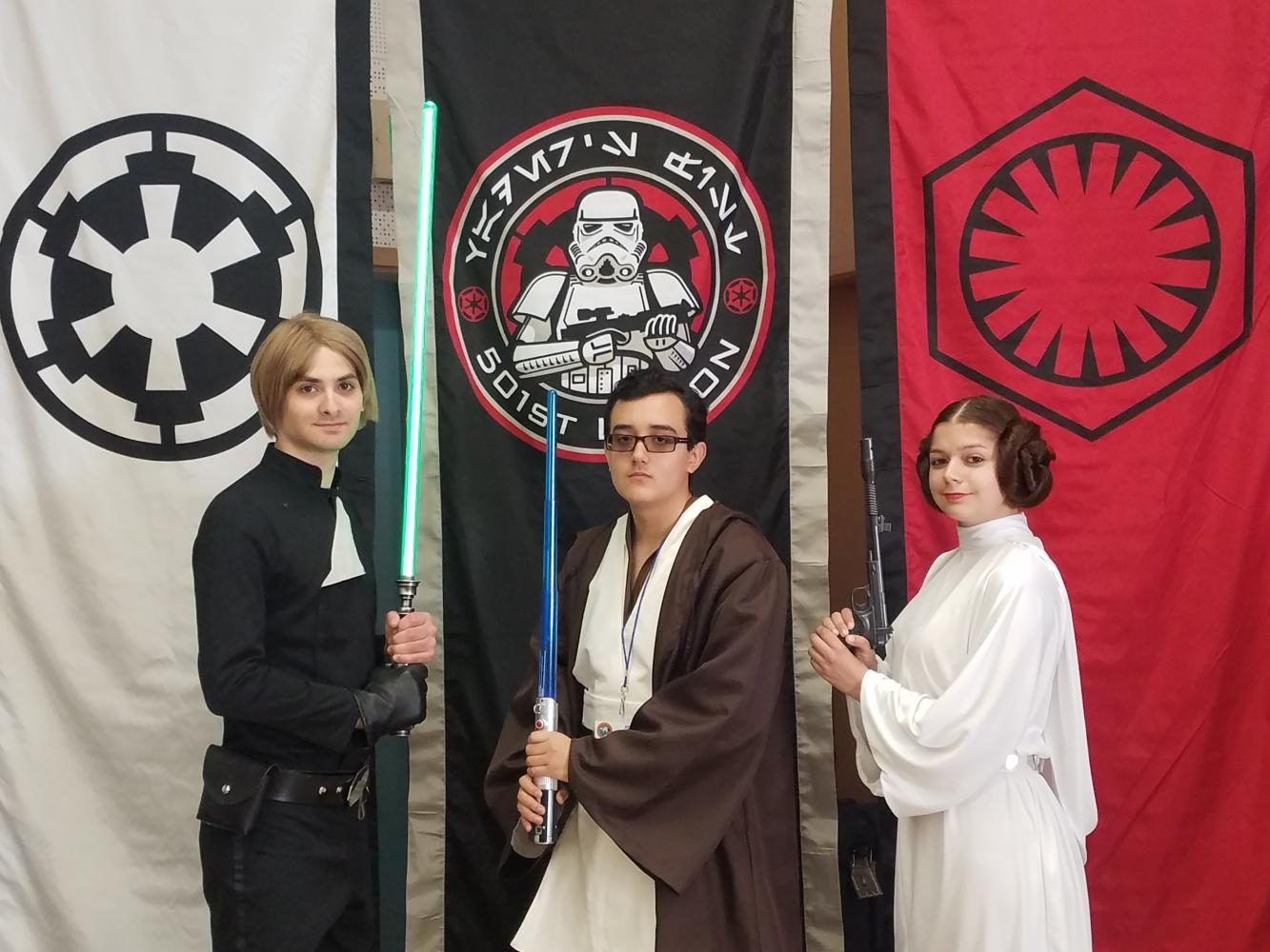 Staff writer Steven Guzman poses in costume with members of the 501st crew.