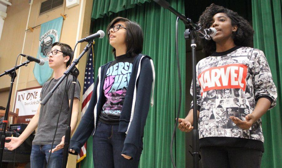 Junior David Palacios, sophomore Emely Felix and senior Katie Lashley recite the classic poem