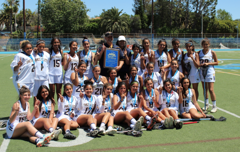 The girls lacrosse team pose with its plaque after winning the Championship game against Palisades High School.
