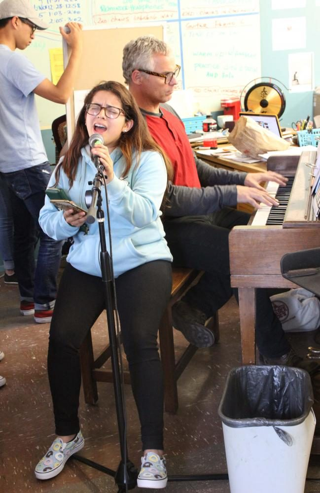 Senior Ana Monterroza sings while music teacher Wes Hambright plays the piano.