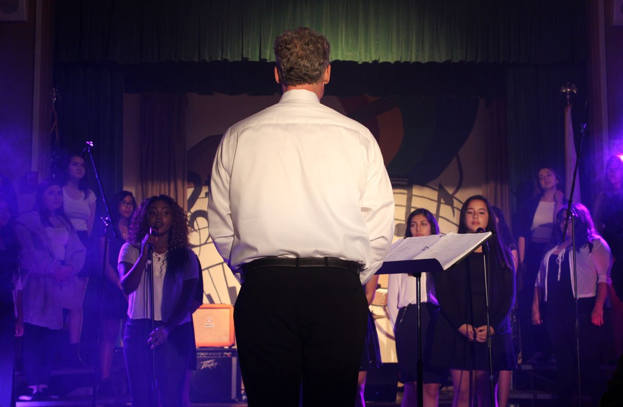 Music teacher Wes Hambright conducts the choir as they sing