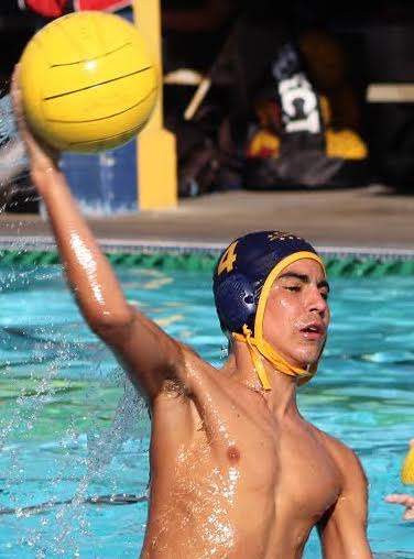 Sophomore Ben Sanchez handles the ball in a water polo game in the fall.