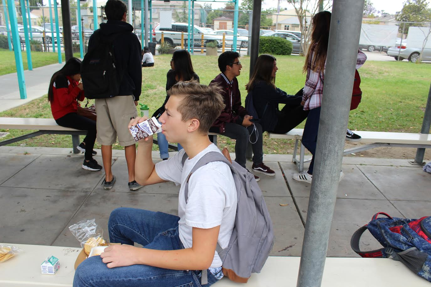 Freshman Ethan Zinshteyn enjoys a sip of chocolate milk during lunch.