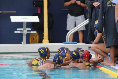 The girls water polo team huddles before the game.