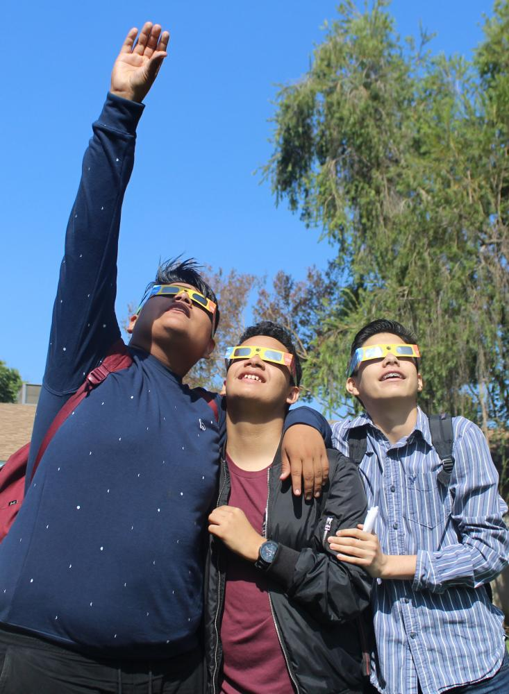Students turned in permission slips in order to view the eclipse, with many joining their friends in The Grove in front of school on Aug. 21, 2017.