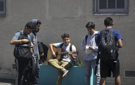 Student fills empty courtyard with music