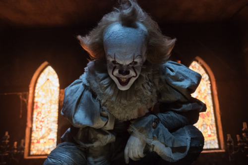 Pennywise (Bill Skarsgard) awakens from slumber and begins to terrorize children