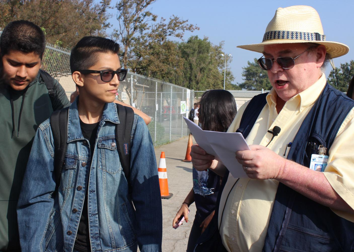 Sophomores Christopher Sarenana and Jason Echeverria listen as science teacher Stephen Schaffter takes roll. Schaffter organizes the school's emergency preparedness plans.