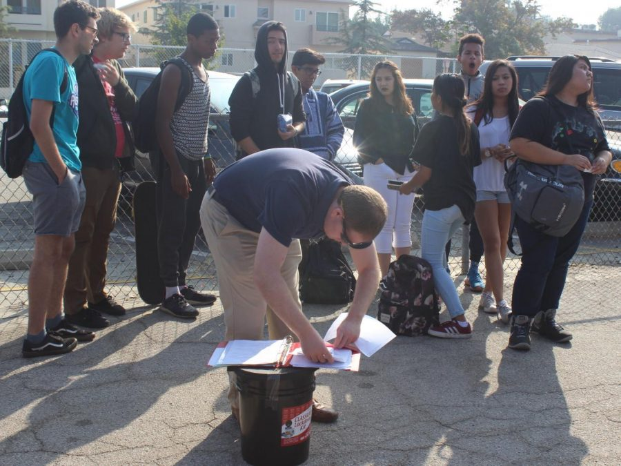 Social sciences teacher Bret Abelson prepares to take roll with his class government class.