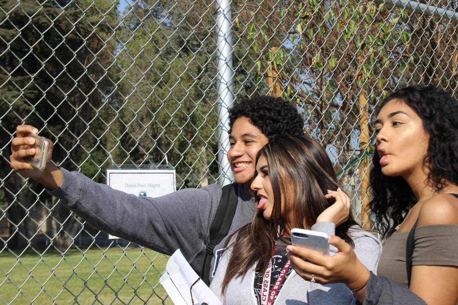 Andres Perkins, Briana Ayala and Elizabeth Ramos take a photo during the Great California ShakeOut on Oct. 19.