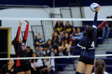 Sophomore Keona Paniagua blocks an opposing hit during the Birmingham Lady Patriots' game against the Verdugo Lady Dons.